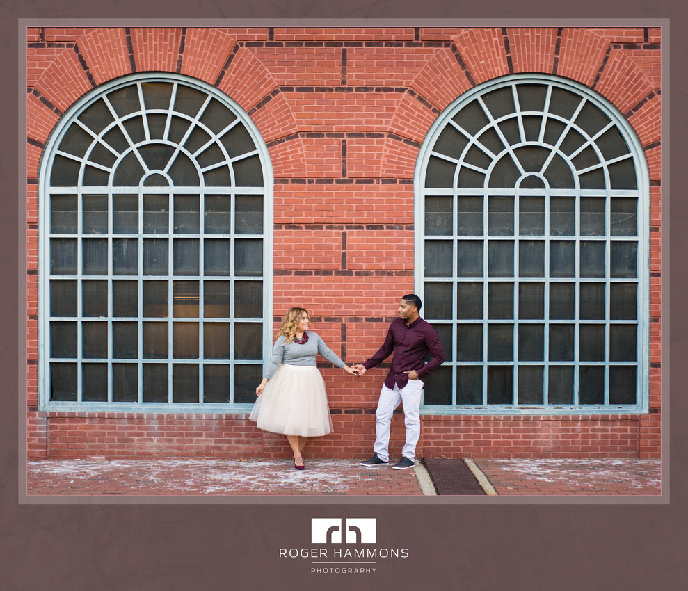 Alexandria, Virginia engagement photograph by Roger Hammons Photography is an environmental portrait featuring characteristic local architecture.
