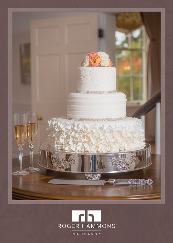 Photograph of a beautiful wedding cake by Wanda's Cakes, taken by Northern Virginia wedding photographer Roger Hammons at a stylized bridal portrait session at Rust Manor House in Leesburg, Virginia