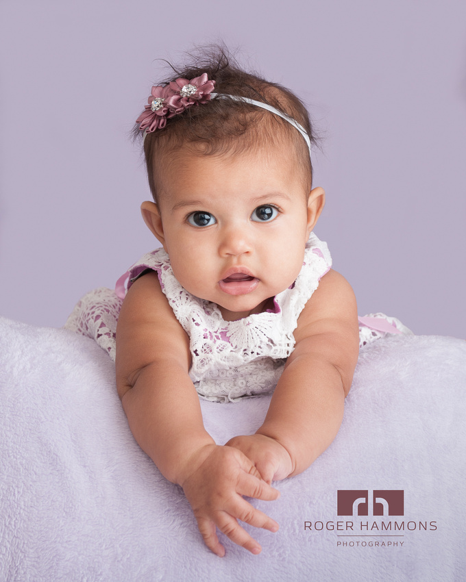 Studio portrait of a four month old baby girl by Ashburn wedding and portrait photographer Roger Hammons  located in Loudoun County in northern Virginia.