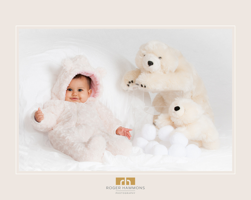 """Northern Virginia family portrait photographer shares image from recent """"Snow Bears"""" mini-session baby portrait taken in his portrait studio in Ashburn, Virginia"""