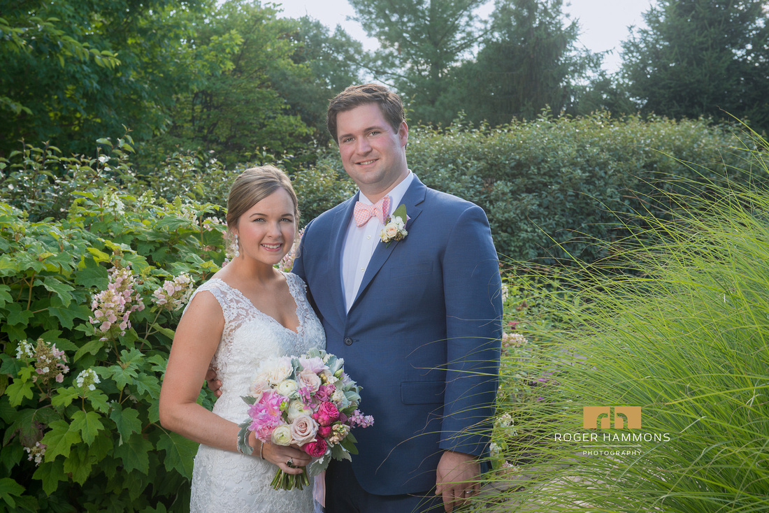 Garden portrait of bride and groom on a summer wedding at Lansdowne Resort by Ashburn wedding photographer Roger Hammons.